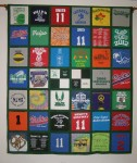 """Twin size with two """"Four-Patch"""" blocks in center using small logos"""