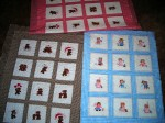 Three little baby quilts